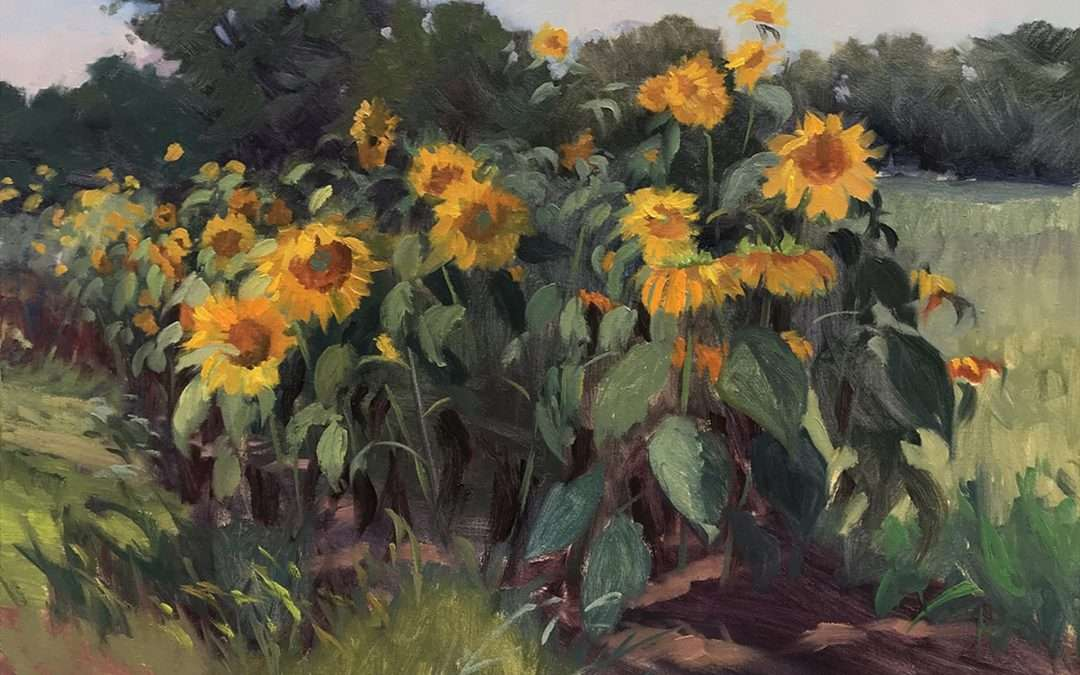 A stand of sunflowers toss in breeze in late September at the edge of a field. Oil by Jacqueline Jones